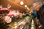 A shopper eyes the chocolate treats of Gourmet Works on Main Street in Los Altos during First Friday.