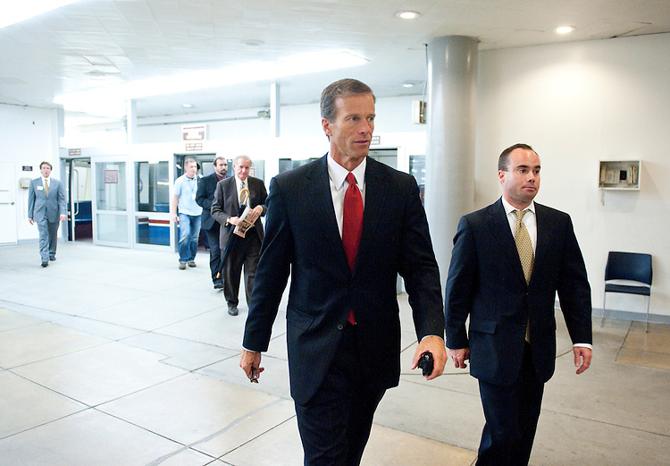 UNITED STATES - SEPTEMBER 20: Sen. John Thune, R-S. Dak., arrives in the Capitol for the Senate Republicans' policy lunch on Tuesday, Sept. 20, 2011. (Photo By Bill Clark/Roll Call)