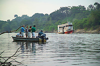 Amazone, Brazil, October 2004. The Amazone river and Rio Negro connect the small rain forest communities that dot the region. River Amazon (Portuguese: Rio Amazonas; Spanish: Río Amazonas) of South America is the largest river in the world by volume, with total river flow greater than all the other top ten largest rivers flowing into the ocean combined. The Amazon drains an area of some 6,915,000 square kilometres (2,670,000 sq mi), or some 40 percent of South America. Photo by Frits Meyst/Adventure4ever.com