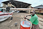 Fueling up before a flight in Kananga, Congo, by Wings of Caring, a program of the United Methodist Church