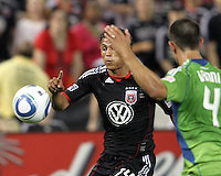 Andy Najar #14 of D.C. United wills the ball past Patrick Ianni #4 of Seattle Sounders FC during an MLS match at RFK Stadium on July 15 2010, in Washington DC.Seattle won 1-0.