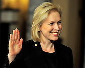 United States Senator Kirsten Gillibrand (Democrat of New York) raises her right hand during the photo-op of the reenactment of her swearing-in in the Old Senate Chamber in the U.S. Capitol in Washington, D.C. on Wednesday, January 5, 2011..Credit: Ron Sachs / CNP.(RESTRICTION: NO New York or New Jersey Newspapers or newspapers within a 75 mile radius of New York City)