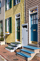 Beautifully painted and colorful facades and entryways decorate historic homes on the narrow streets of Annapolis, Maryland.  These homes also show decorative touches for the upcoming celebration of Halloween.