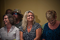 A group of 16 public employees who has been won one of three winning tickets in last week's $448 million Powerball jackpot, attend a press conference in Toms River New Jersey August 13, 2013 by Kena Betancur / VIEWpress