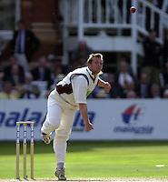 Photo Peter Spurrier.31/08/2002.Cheltenham & Gloucester Trophy Final - Lords.Somerset C.C vs YorkshireC.C..Yorkshire batting;  Matt Elliott. and Michael Vaughan.Somerset Bowling Keith Dutch