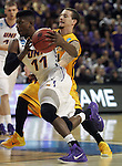 Northern Iowa's Wes Washpun (11) drives past Wyoming's Josh adams during their  2015 NCAA Division I Men's Basketball Championship March 20, 2015 at the Key Arena in Seattle, Washington.   Northern Iowa beat Wyoming 71 to 54.   ©2015.  Jim Bryant Photo. All Rights Reserved.