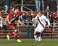 Virginia Tech midfielder Robert Alberti (6) brings the ball forward as Boston College defender Matt Wendelken (8) closes.Boston College (maroon) defeated Virginia Tech (Virginia Polytechnic Institute and State University) (white), 3-1, at Newton Campus Field, on November 3, 2013.