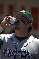 Jonny Gomes drinks an energy drink. Baseball: Tampa Bay Devil Rays vs Oakland Athletics at McAfee Coliseum in Oakland, CA on August 13, 2006. Photo by Brad Mangin