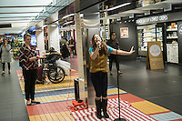 "Hannah Florence, performing in Cirque du Soleil's Broadway musical ""Paramour"", sings songs from the musical at a lunchtime performance in Turnstyle, a shopping and foodie arcade in the subway in New York Tuesday, November, 29, 2016. ""Paramour"" is at the Lyric Theatre and is about the golden age of Hollywood. (© Richard B. Levine)"