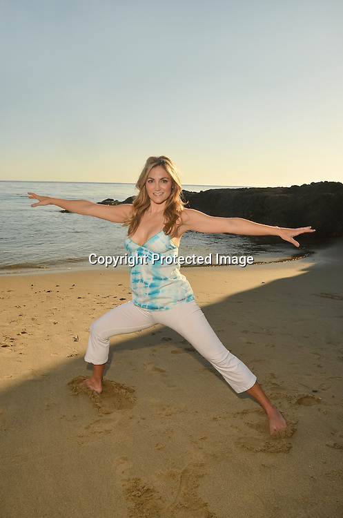 Stock image of Young woman doing evening yoga at a Southern California Beach