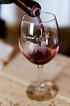 A taste of red wine is poured into my glass at General's Ridge Vineyard and Winery.