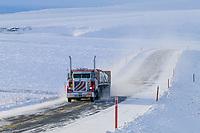 Truckers hauls supplies along the James Dalton Highway in winter, Arctic Alaska