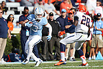 24 October 2015: UNC's Ryan Switzer (3) and Virginia's Wilfred Wahee (28). The University of North Carolina Tar Heels hosted the University of Virginia Cavaliers at Kenan Memorial Stadium in Chapel Hill, North Carolina in a 2015 NCAA Division I College Football game. UNC won the game 26-13.