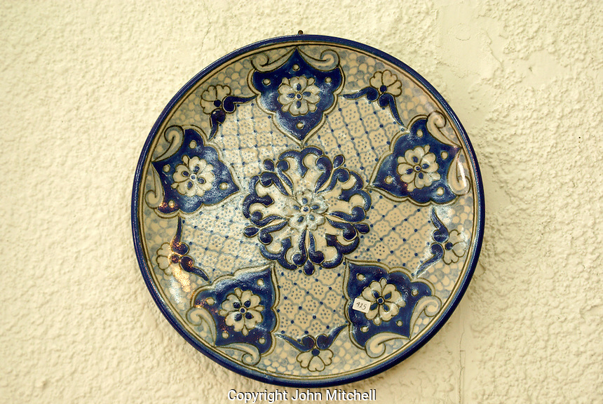 Genuine blue and white Talavera plate for sale in Cholula, Puebla, Mexico. Cholula is a UNESCO World Heritage Site.