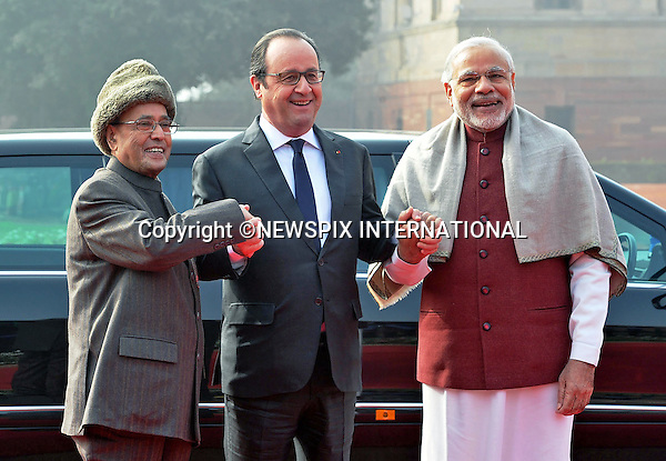 25.01.2016; New Delhi, India: PRESIDENT HOLLANDE OF FRANCE <br /> is greeted by Indian President Pranab Mukherjee and Prime Minister Narendra Modi at the Ceremonial Reception,Rashtrapati Bhavan<br /> The French President in the guest of honour for the Republic Day celebrations on the 26th of January 2016.<br /> Mandatory Credit Photos: &copy;NEWSPIX INTERNATIONAL<br /> <br /> PHOTO CREDIT MANDATORY!!: NEWSPIX INTERNATIONAL(Failure to credit will incur a surcharge of 100% of reproduction fees)<br /> <br /> IMMEDIATE CONFIRMATION OF USAGE REQUIRED:<br /> Newspix International, 31 Chinnery Hill, Bishop's Stortford, ENGLAND CM23 3PS<br /> Tel:+441279 324672  ; Fax: +441279656877<br /> &quot;All fees payable to &quot;Newspix International&quot;<br /> e-mail: info@newspixinternational.co.uk