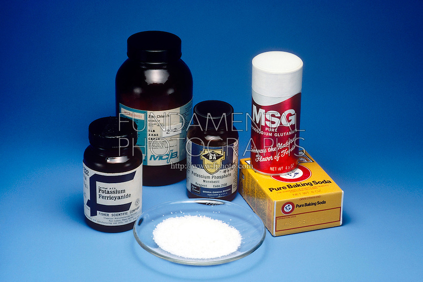 ASSORTED SALTS<br /> Group of Household and Lab Grade Salts<br /> Counter clockwise from left: potassium ferricyanide, zinc chloride, potassium phosphate, monosodium glutamate, baking soda, and table salt.
