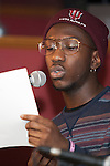 """Marcus Cole reads an original poem at """"Creative Arts as Activism – Social Justice-Themed Open Mic Night,"""" at Casa Nueva Restaurant and Cantina on January 20, 2016. Cole said he wrote the poem in a creative writing class. ©Ohio University/Photo by Kaitlin Owens"""