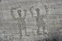Petroglyph, rock carving, of two warriors with swords  carved by the ancient Camuni people in the iron age between  900-1200 BC. Rock 26-27, Foppi di Nadro, Riserva Naturale Incisioni Rupestri di Ceto, Cimbergo e Paspardo, Capo di Ponti, Valcamonica (Val Camonica), Lombardy plain, Italy