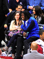 Redskins' quarterback Robert Griffin III watches the game with his fiancee. Washington Wizards defeated the Miami Heat 105-101 at the Verizon Center in Washington, D.C. on Tuesday, December 4, 2012.   Alan P. Santos/DC Sports Box