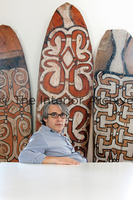 Collector Fabio Sartoretto sitting in front of his Asmat Shields