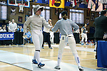 12 February 2017: UNC's Jackie Litynski (left) and Duke's Haley Fisher (right) during Saber. The Duke University Blue Devils hosted the University of North Carolina Tar Heels at Card Gym in Durham, North Carolina in a 2017 College Women's Fencing match. Duke won the dual match 14-13 overall and 7-2 in Epee. UNC won Foil 6-3 and Saber 5-4.