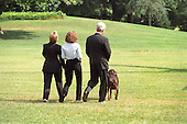 &quot;Buddy&quot; the dog leads the First Family to Marine 1 on the South Lawn of the White House on August 19, 1999.  The Clintons are to vacation for 2 weeks in Martha's Vineyard.  From left to right: First lady Hillary Rodham Clinton, Chelsea Clinton, United States President Bill Clinton, &quot;Buddy&quot; the dog. On Tuesday, August 17, 1999, the President testified before the Grand Jury on his involvement in the Monica Lewinsky scandal and subsequently made a nationally televised statement admitting he had an inappropriate relationship with Ms. Lewinsky.<br /> Credit: Ron Sachs / CNP