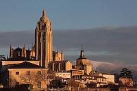 Segovia Cathedral, (Catedral de Segovia, Catedral de Santa Maria), 1525-77, by Juan Gil de Hontanon (1480-1526), and continued by his son Rodrigo Gil de Hontanon (1500-1577) (right), Segovia, Castile and Leon, Spain, with the  mountainous winter landscape in the background. Picture by Manuel Cohen