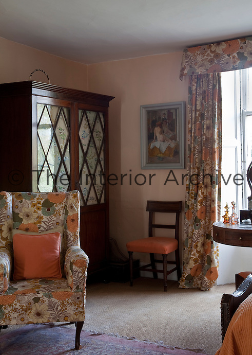 The twin bedroom furnished with matching floral fabric and pastel shades