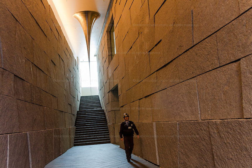A security guard in a artistic entrance hall to a building in Omotesando Tokyo, Japan. Friday November 21st 2014