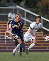 Quinnipiac University forward Philip Suprise (15) passes the ball as Boston College midfielder/defender Colin Murphy (21) defends. Boston College defeated Quinnipiac, 5-0, at Newton Soccer Field, September 1, 2011.