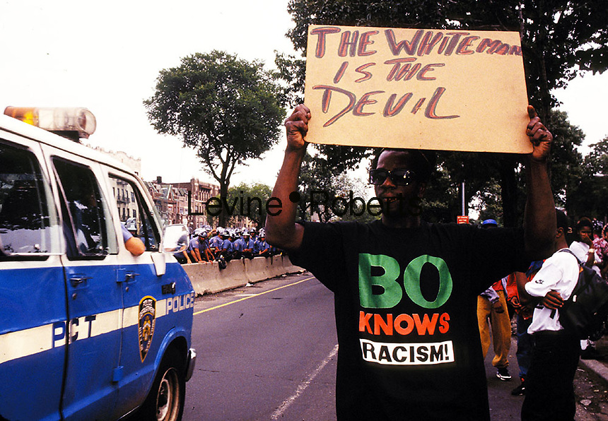IN ADVANCE FOR 20TH ANNIVERSARY OF CROWN HEIGHTS RIOTS IN BROOKLYN, NY ON AUGUST 19, 1991. Protestor on Eastern Parkway during days following riots in Crown Heights in August 1991. Gavin Cato was the youth accidentally run over by the Lubavitcher Rebbe's auto procession in Crown Heights. (© Richard B. Levine)
