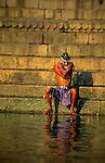 Asia, India, Varanasi. Man bathes in the sacred Ganges River.