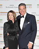 Washington, DC - December 5, 2009 -- United States Speaker of the House Nancy Pelosi (Democrat of California) and her husband, Paul Pelosi arrive for the formal Artist's Dinner at the United States Department of State in Washington, D.C. on Saturday, December 5, 2009..Credit: Ron Sachs / CNP.(RESTRICTION: NO New York or New Jersey Newspapers or newspapers within a 75 mile radius of New York City)