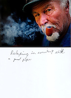 "This is a scan of a print that was given to the subject, Gary Seymour, so that he could write his thoughts. He wrote:..""Relaxing in evening with a good pipe""..Ventura, California, July 21, 2010 - A portrait of Gary Seymour at his home, a camper parked left to him by his father that is parked in the driveway of a friend's mother. Because it is an illegal camp, Mr. Seymour is considered homeless. Mr. Seymour has been homeless off and on for the last thirty years. He says, ""I work odd jobs, landscaping and whatnot to make a little money. I am trying to get back on my feet."" Mr. Seymour is proud that he does not panhandle. ""I earn my own living without asking people for handouts."" ..."