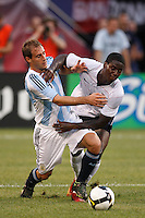 United States forward Eddie Johnson (9) and Argentina defender Pablo Zabaleta (13). The men's national teams of the United States and Argentina played to a 0-0 tie during an international friendly at Giants Stadium in East Rutherford, NJ, on June 8, 2008.