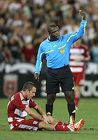 Eric Alexander #24 of FC Dallas with referee Abiodun Okulaja during an MLS match against D.C. United at RFK Stadium in Washington D.C. on August 14 2010. Dallas won 3-1.