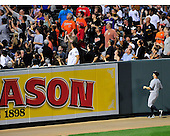 New York Yankees left fielder watches as Baltimore Oriole first baseman Mark Reynolds second inning home run goes into the stands against the Baltimore Orioles at Oriole Park at Camden Yards in Baltimore, MD on Friday, August 26, 2011..Credit: Ron Sachs / CNP.(RESTRICTION: NO New York or New Jersey Newspapers or newspapers within a 75 mile radius of New York City)