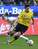 Fussball 1. Bundesliga :  Saison   2010/2011   32. Spieltag  21.04.2012 Borussia Dortmund - Borussia Moenchengladbach  Marco Reus (li, Borussia Moenchengladbach) gegen Mats Hummels (Borussia Dortmund)