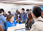 People at Apple Genius Bar technical support centre in Ginza, Tokyo, Japan 2014