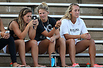 14 August 2015: UNC women's soccer players Alexa Newfield (left), Katie Bowen (NZL) (middle), and Summer Green (right) watch the game. The University of North Carolina Tar Heels hosted the Winthrop University Eagles at Fetzer Field in Chapel Hill, NC in a 2015 NCAA Division I Men's Soccer preseason exhibition. North Carolina won the game 4-1.