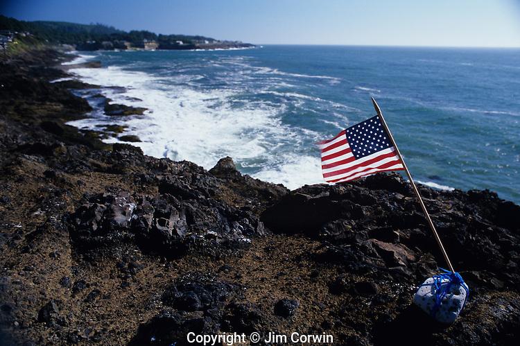 American flag on rocky coastline along Highway 101 after nine eleven 9/11 Depoe Bay, Oregon Coast Oregon State  USA