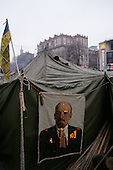 """Kiev, Ukraine.December 27, 2004..Tents set along Kreshatik, the central street in Kiev where demonstrators lived for nearly a month to overturn what they felt was a rigged election. In a second round of voting, that they won, the polls show Viktor Yushchenko, the opposition candidate, in a strong lead over Viktor Yanukovich with 98% of the vote counted. ..The first round of voting was considered fraudulent when the ruling president Viktor Yahukovich won and the opposition candidate Viktor Yushchenko lost. ..Several hundred thousand Ukrainians took to the streets of Kiev and held daily rallies on Maidan Independence Square. The protests lasted nearly a month before the first vote was declared invalid and a new round of elections held on December 26, 2004. ..The demonstrations would come to be known as the """"Orange Revolution"""" after the color of the opposition party."""