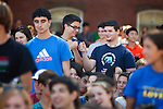 08/29/2012 - Medford/Somerville, Mass. - First-year engineering students fist bump as they are recognized during Matriculation on Wednesday, Aug. 29, 2012. (Kelvin Ma/Tufts University)