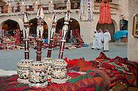 "Doha, Qatar.  Market Scene, in the Recently Modernized ""Traditional"" Market.  Qatari Men in Dishdashas with Kaffiya (Ghutra), and Black Agal (Egal)."