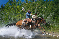 Mountain View, Alberta, Canada, July 2008. Rancher Dan Nelson and cowboy Calin Duce race through the river. They take us on a horse back trail ride in the hills connecting the Albertan prairie with the mountains of Waterton National Park. Photo by Frits Meyst/Adventure4ever.com