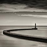 Roker Lighthouse, Roker, Sunderland, England with calm sea