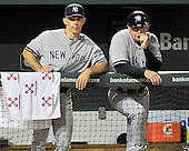 New York Yankees manager Joe Girardi (28), left, and third base coach Rob Thomson (59) watch late inning action against the Baltimore Orioles at Oriole Park at Camden Yards in Baltimore, MD on Friday, August 26, 2011.  The Orioles won the game 12 - 5..Credit: Ron Sachs / CNP.(RESTRICTION: NO New York or New Jersey Newspapers or newspapers within a 75 mile radius of New York City)
