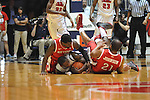 "Rutgers' Eli Carter (5), Mississippi's Murphy Holloway (31), and Rutgers' Austin Johnson (21) go for a loose ball at the C.M. ""Tad"" Smith Coliseum in Oxford, Miss. on Saturday, December 1, 2012. (AP Photo/Oxford Eagle, Bruce Newman).."