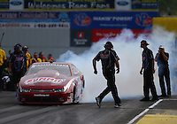 Jun 3, 2016; Epping , NH, USA; NHRA pro stock driver Greg Anderson does a burnout during qualifying for the New England Nationals at New England Dragway. Mandatory Credit: Mark J. Rebilas-USA TODAY Sports