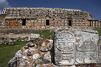 """The Codz Poop?s Altar of the Glyphs, square layout of 21 feet on each side, four faces with carved, bas-relief glyphs, western façade of the Codz Poop (""""Rolled-up matting"""" in Maya) in the background, Puuc Architecture, 700 ? 900 AD, Kabah, Yucatan, Mexico. Picture by Manuel Cohen"""